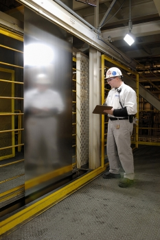 Worker from PRO-TEC inspecting coated steel (Photo: PRO-TEC)