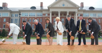 State and local officials celebrate groundbreaking with shovelsful of earth (Photo credit: MCNC)
