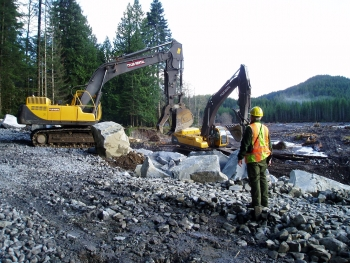 Workers prepare to reconstruct flooded road (File photo: National Park Service)