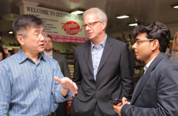 Locke, Alex Lintner and store owner, Deepak Gupta