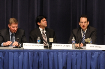 The three principal speakers at forum table