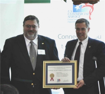 Tektite founder, Scott Mele, receiving the Export Achievement Award from the Department of Commerce. Scott Mele on left, Congressman Rush Holt on right.