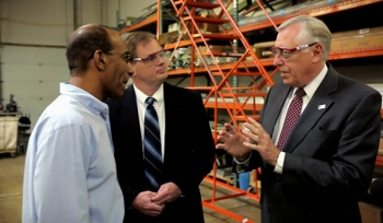 Whip Hoyer discusses the Make It In America agenda with employees at Antenna Research Associates, Inc., a manufacturer in Maryland's fifth district.
