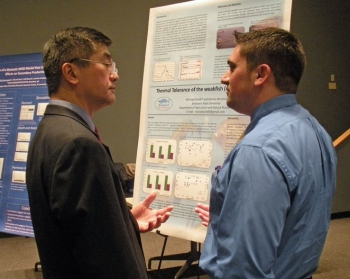 Secretary Locke Talks with a Student at NOAA's Science Center in Silver Spring, MD about His Research