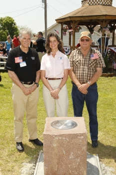 In the photo are (left to right) Dr. Robert Groves, Juliana Blackell & Bob Biram  - Village Chairman.