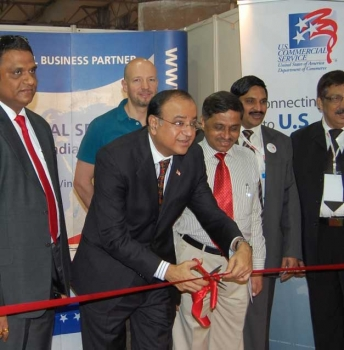 Suresh Kumar cutting a ribbon opening the Commercial Service Pavillion