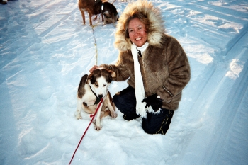 Dee Alexander with an Alaskan Husky during the Census Enumeration on January 25, 2010 in Noorvik, Alaska.