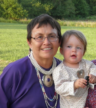 Jan Jacobs at the I'n-lon-shka dances with her granddaughter