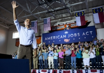 President Barack Obama delivers remarks on the American Jobs Act at West Wilkes High School in Millers Creek, North Carolina, Oct. 17, 2011 (Official White House Photo by Pete Souza)