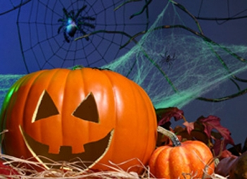 Image of jack-o-lantern, pumpkin and spider web