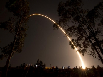 An arc of light illuminates the pre-dawn sky at Vandenberg Air Force Base, Calif., as a Delta II rocket launches with the NPOESS Preparatory Project (NPP) spacecraft payload.