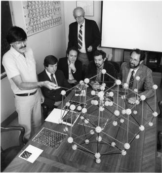 Meeting at the National Institute of Standards and Technology (NIST) in 1985 just months after shaking the foundations of materials science with publication of his discovery of quasicrystals, Daniel Shechtman, winner of the 2011 Nobel Prize in Chemistry, discusses the material's surprising atomic structure with collaborators.  From left to right are Shechtman; Frank Biancaniello, NIST; Denis Gratias, National Science Research Center, France;  John Cahn, NIST; Leonid Bendersky, Johns Hopkins University (now at NIST); and Robert Schaefer, NIST.
