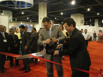 Under Secretary of Commerce for International Trade Francisco J. SÁnchez Cutting a Ribbon at Trade Show in 2011