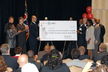 Director Hinson and officials shown with presentation check