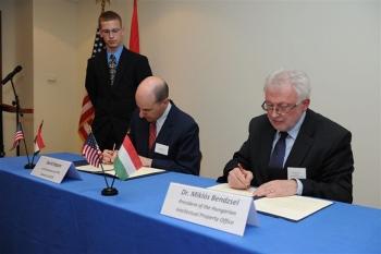 Kappos and Miklós Bendzsel signing a memorandum of understanding