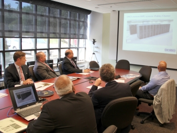 Erskine (left) at presentation showing time-lapse sequence of the building of the Ohio Supercomputer Center. (Photo: the Ohio Supercomputer Center)