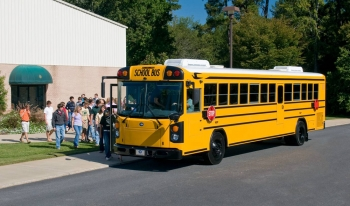 Image of students boarding a yellow school bus