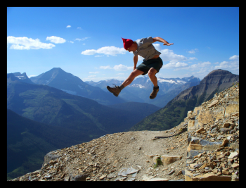 Happy tourist jumping in Glacier National Park