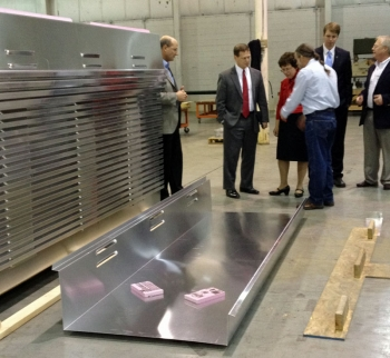 SolarDock founder Scott Johnson and MJM Fabrications President Mike Molder give Lt. Gov Matt Denn and Acting Deputy Secretary Rebecca Blank a tour of their facilities