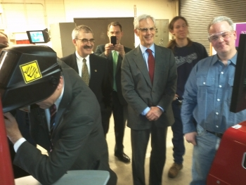 Secretary Bryson Enjoys Mayor Rybak's Attempts at Welding