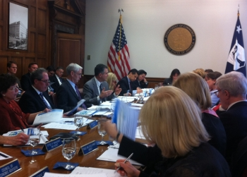 Bryson and participants seated at conference table