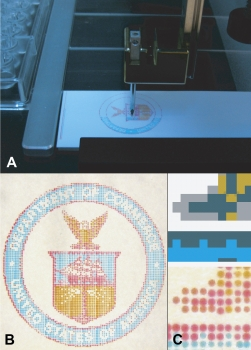 Microarrayer machines (A) now can mix colors and deposit them on microscope slides, which can be used to calibrate hyperspectral imagers (HSI) for use in medical applications. The finished slides can be custom-colored (B) to calibrate HSIs to find specific types of tumors or disease tissue. Close up, they resemble dot-matrix printwork (C). Photo: Clark/NIST