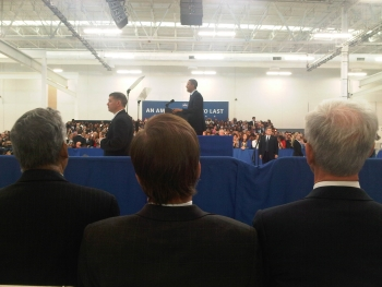 From the front row, Secretary Bryson watches President Obama at the Rolls-Royce Crosspointe Manufacturing Plant