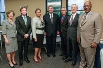 Secretary Bryson, second from right, poses with government and university officials