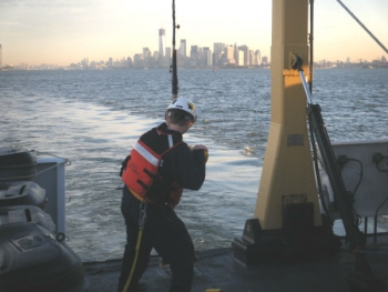 As the sun comes up in New York this morning, Ensign Lindsey Norman retrieves the side scan sonar that NOAA Ship Thomas Jefferson used to survey the Hudson River, so fuel barge traffic could resume.