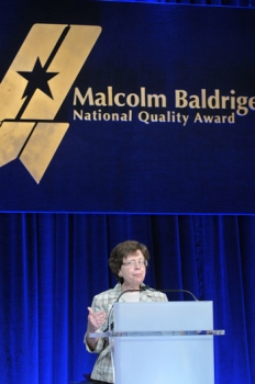 Deputy Secretary Rebecca Blank presenting the Malcolm Baldrige National Quality Award, the nation's highest Presidential honor for organizational performance excellence and innovation