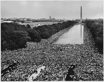 View of the National Mall teeming with thousands around the Reflecting Pool (photo: National Archives)