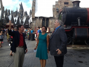 Secretary Penny Pritzker at Universal Studios Wizarding World of Harry Potter with COO Bill Davis (left) and John Sprouls, Executive VP (right)