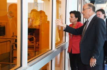 Secretary Penny Pritzker looks into a cleanroom with Paul Farrar, General Manager of Global 450mm Consortium (G450C) (Photos courtesy of SUNY's College of Nanoscale Science and Engineering (CNSE))