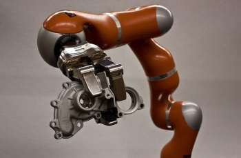 Image of a seven degree-of-freedom highly dexterous robot and a seven degree-of-freedom, three fingered robotic hand.