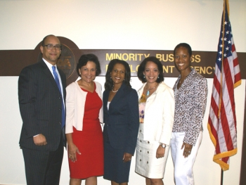 Secretary Penny Pritzker Stands with the MBDA Leadership Team Outside Their Offices