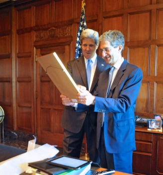 Acting Secretary Cameron Kerry is joined by his brother, Secretary of State John Kerry, in the Secretary's Office