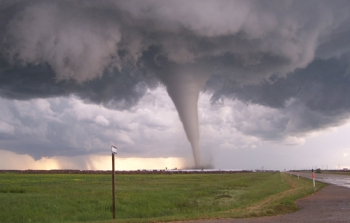 A tornado funnel cloud