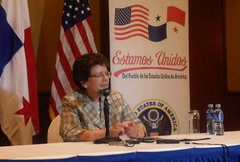 De. Blank seated at speakers' table at AmCham Panama