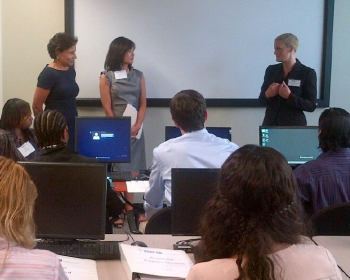 Secretary Pritzker visiting the IT Apps class where students use office productivity applications to build their own business plan, which they present to the class as a final project.