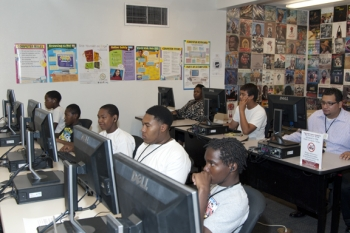 Las Vegas Urban League: Young visitors to the Doolittle Community Center use the free Internet access to work on school projects.