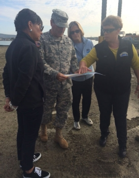 Secretary Pritzker reviewing plans in Nome, Alaska with Joy Baker, Col. Christopher Lestochi and NOAA Administrator Dr. Kathryn Sullivan