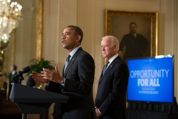 President Barack Obama, with Vice President Joe Biden, delivers remarks at an event to outline new efforts to help the long-term unemployed, in the East Room of the White House, Jan. 31, 2014. (Official White House Photo by Pete Souza)