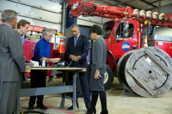 President Barack Obama with Commerce Secretary Penny Pritzker views demonstration of fiber optic spicing at Cedar Falls Utilities in Cedar Falls, Iowa, Jan. 14, 2015. (Official White House Photo by Pete Souza)