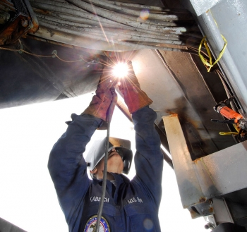 A US Navy welder works at the Puget Sound Naval Shipyard. Photo courtesy US Navy