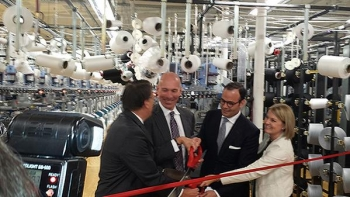 Under Secretary Stefan Selig (seond from left) participates in a ribbon cutting ceremony with North Carolina Governor Pat McCrory (left) PEDS Legwear President and CEO Michael Penner and Walmart Vice President of U.S. Manufacturing Cindi Marsiglio