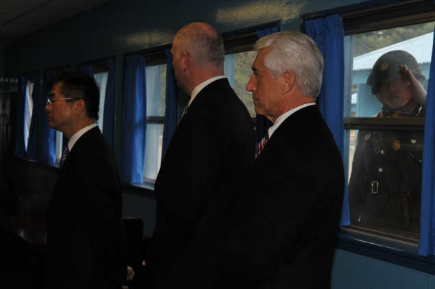 Secretary Locke, Congressman Crowley and Congressman Reichert receiving a briefing at the DMZ