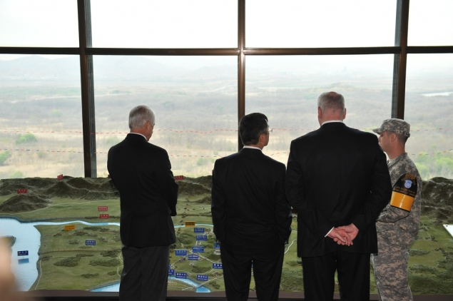 Secretary Locke, Congressman Crowley and Congressman Reichert overlooking North Korea