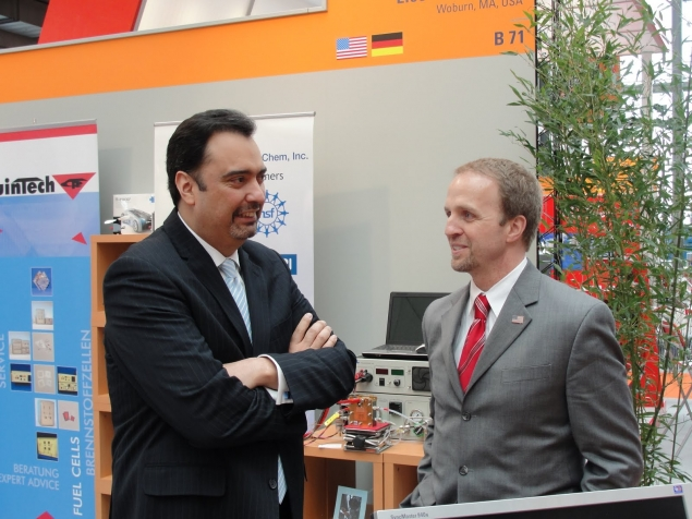 Deputy Assistant Secretary of Commerce for Economic Development Brian McGowan confers with Assistant Secretary of Commerce for Market Access and Compliance Michael Camunez, after touring the hydrogen fuel cell exhibit at the Hannover Messe trade show in Hannover, Germany .