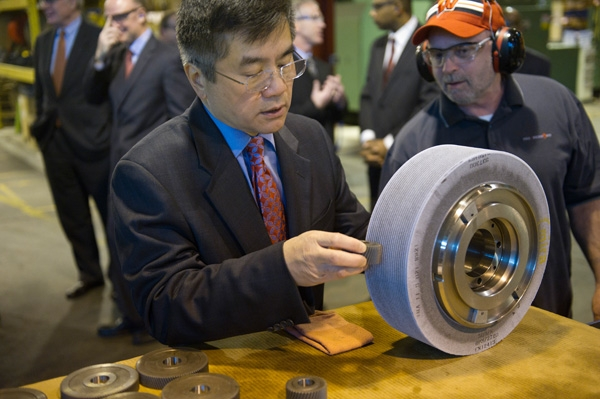 Secretary Gary Locke Uses a Grinding Wheel