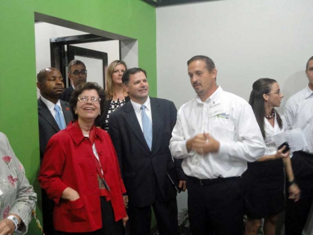Acting Secretary Blank and Ovation Networks employees tour their facility in Cedar Rapids